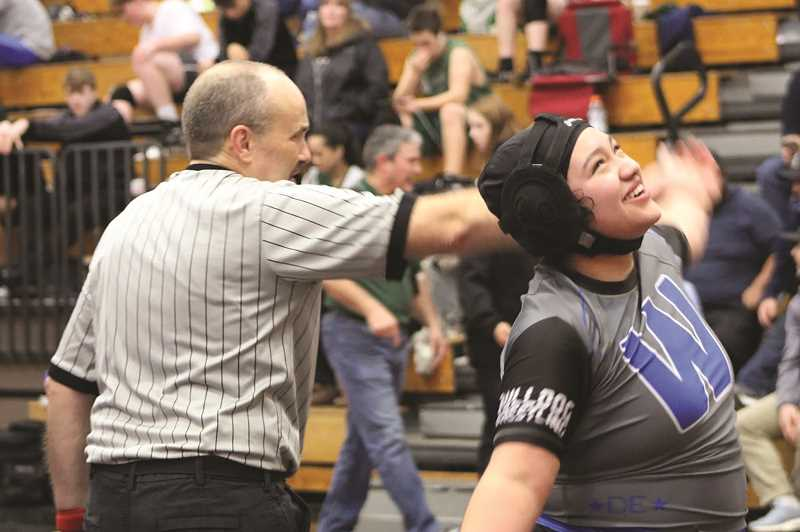 COURTESY PHOTO: WOODBURN WRESTLING - Woodburns Areli  Valtierra celebrates her third-round win over Lincolns Dina Ross to win the 190-pound championship at Southridge.