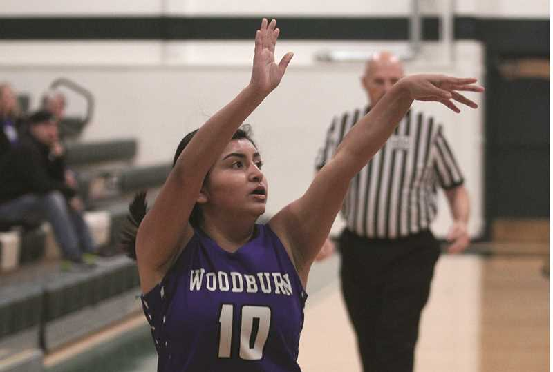 PMG FILE PHOTO: PHIL HAWKINS - Woodburn senior Lina Cabrera torched the Sisters Outlaws for 25 points, connecting on 5-of-6 3-pointers and finishing 9-of-13 from the field in the Bulldogs 58-31 win on Friday.