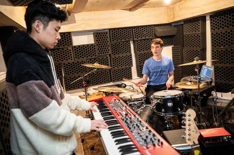 PMG PHOTO: JONATHAN HOUSE - Josh Orth, left, Paul Corso, right and Andrea Nguyen, not pictured, practice prior to this Fridays Snowchella.