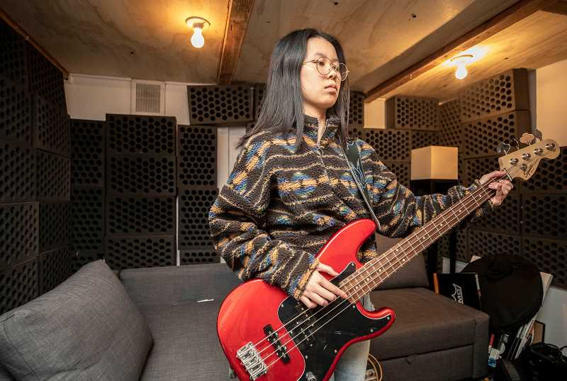 PMG PHOTO: JONATHAN HOUSE - Andrea Nguyen practices on the bass guitar before this weeks Snowchella.