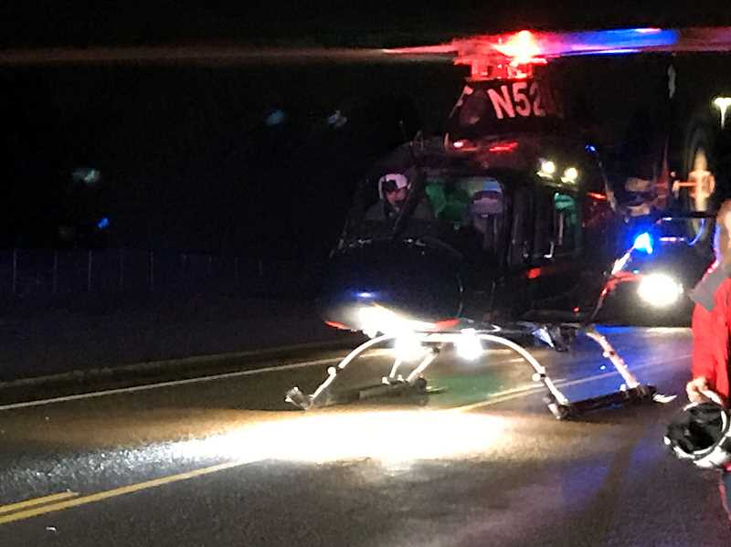COURTESY OF THE CLACKAMAS COUNTY SHERIFFS OFFICE - Life Flight transported one driver to an area hospital following a two-vehicle crash just after midnight Wednesday north of Aurora.