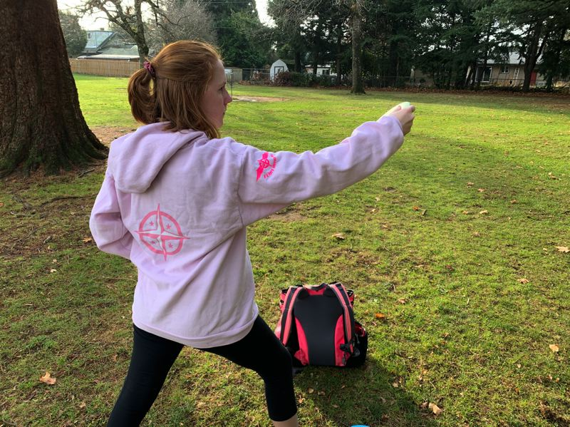 COURTESY PHOTO - Lucy Birks is a sponsored professional disc golf player and working with others at Sandy High to install a dic golf course.