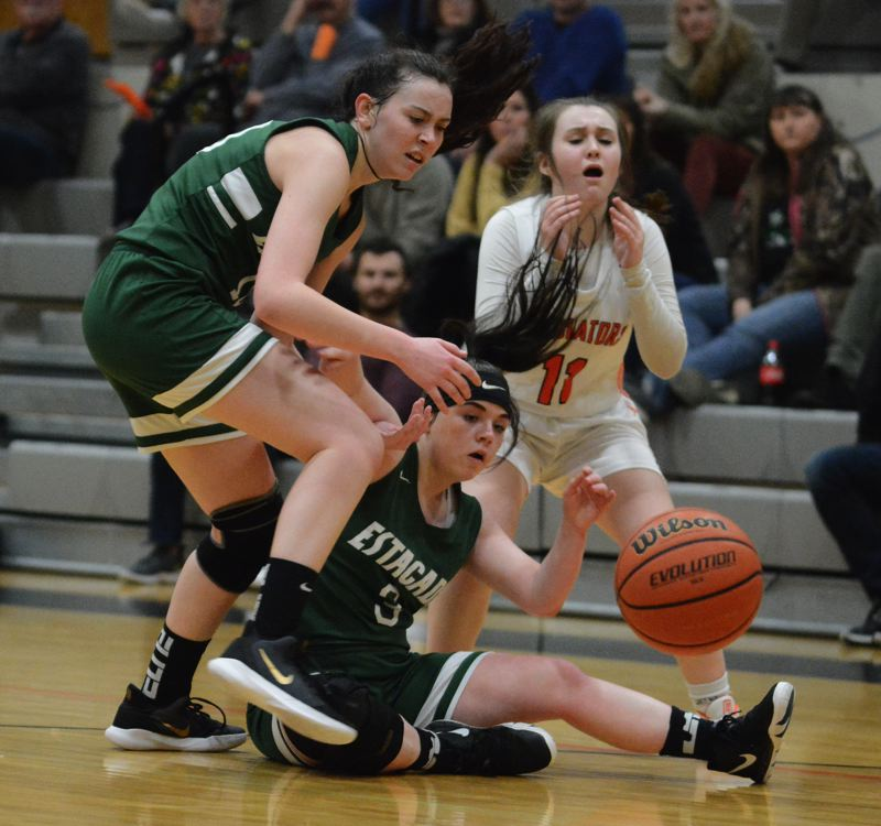 PMG PHOTO: DAVID BALL - Estacadas Nicole Youngberg (left) and Rylie Gipple collide ahead of Gladstones Sam Jedrykowski while the ball bounces away.