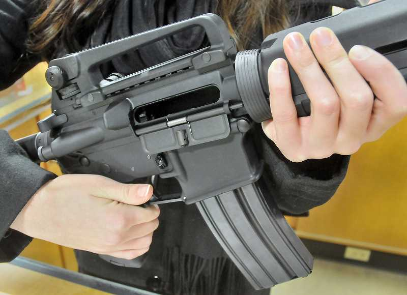 GRAPHIC FILE PHOTO - Legislation expected to be proposed in the next session of the Oregon Legislature would require that gun owners keep their firearms in a locked container such as a gun safe or a room and secured with a trigger lock.