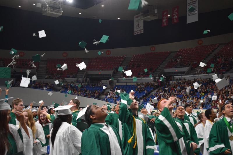 PMG FILE PHOTO - Reynolds High School grads sent their mortarboards skyward in 2019.