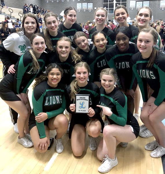COURTESY PHOTO - The West Linn High School cheer team poses with its first-place plaque after winning the Pacer Invitational at Lakeridge High School on Jan. 18.