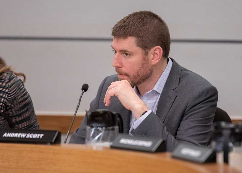 PMG PHOTO: JONATHAN HOUSE - Portland Public Schools board member Andrew Scott listens to staff input during a school board meeting Jan. 21. Scott was one of six who voted to amend the master plan for Lincoln High School and eliminate a planned student health clinic.