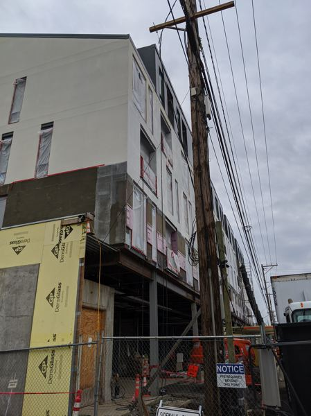 PMG: JOSEPH GALLIVAN - Not its usual boxy style, Works Progress Architecture is building a five-story, 64-unit, mixed-use building next to the I-405 on-ramp.