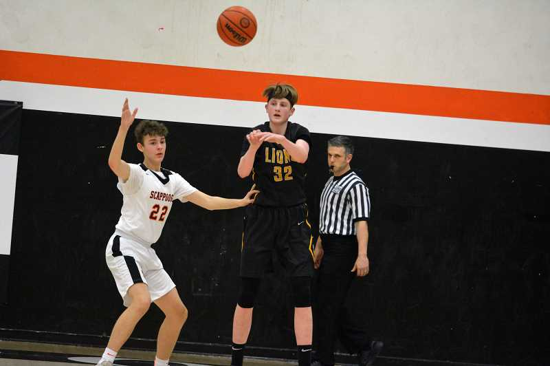 PMG PHOTO :MATT SINGLEDECKER - St. Helens post Neil Wolfe passes out of the post against Scappoose last week.