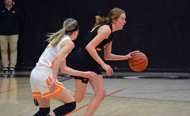 PMG PHOTO: MATT SINGLEDECKER - St. Helens star Maddie Holm took over the fourth quarter on both ends of the floor against Scappoose.