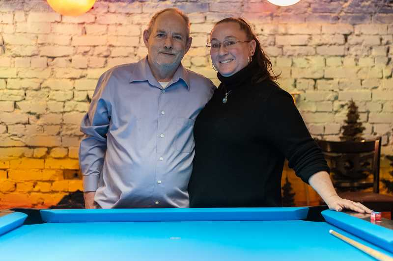 PMG PHOTO: CHRISTOPHER OERTELL - Don and Melinda Yeargin stand behind one of their many pool tables at The Lazy Eye in Forest Grove. Yeargin is legally blind and has a lazy eye, so she named the pool hall after it.