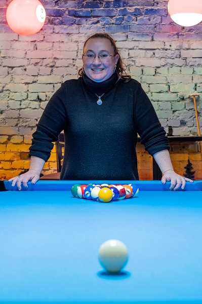 PMG PHOTO: CHRISTOPHER OERTELL - Melinda Yeargin owns The Lazy Eye pool hall on Pacific Ave. in Forest Grove. She opened the business last October.