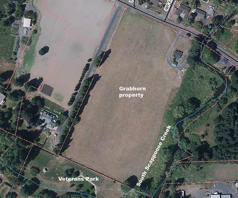 COURTESY IMAGE (PMG ADDED DESCRIPTORS) - A screenshot of the target Grabhorn property as it appears on a GIS aerial photograph updated as of May. The pending purchase would be for the large field in the center of the image. The road abutting the northern edge of the property is EJ Smith Road.
