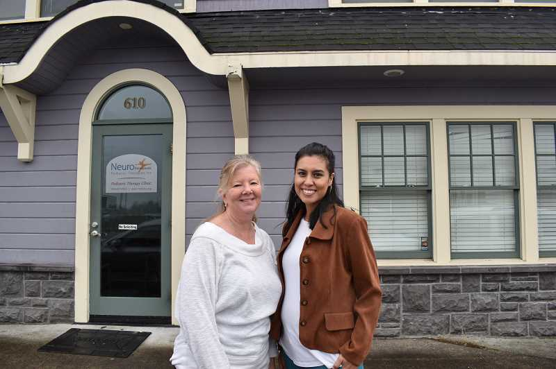 PMG PHOTO: RAYMOND RENDLEMAN - Karen Brelje, Neurotherapeutic Pediatric Therapies executive director, joins mental health therapist Stephanie Caballero outside the organization's Oregon City clinic.