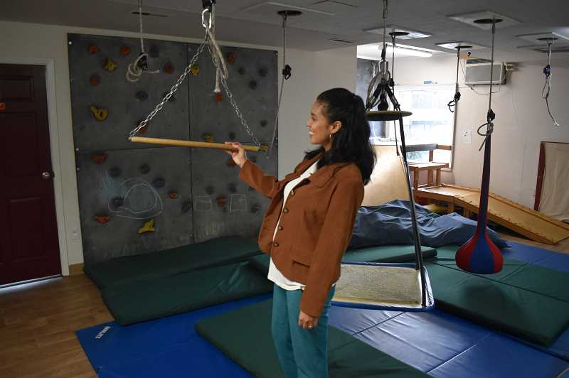 PMG PHOTO: RAYMOND RENDLEMAN - Neurotherapeutic Pediatric Therapies mental health therapist Stephanie Caballero shows off some of the safe places for children to play at the Oregon City clinic.