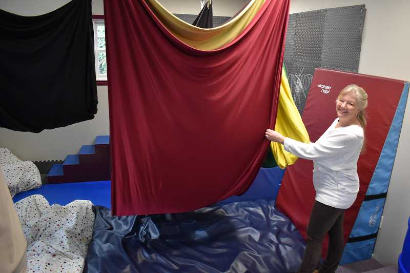 PMG PHOTO: RAYMOND RENDLEMAN - Neurotherapeutic Pediatric Therapies Executive Director and registered nurse Karen Brelje say these fabric swings provide a positive tactile experience for many children struggling to express themselves.