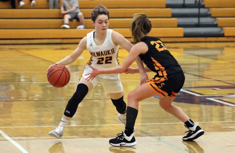 PMG PHOTO: JIM BESEDA - Milwaukie's Cali Denson (22) tries to get around Scappoose's Adi Stoddard (23) during the first half of Tuesday's Northwest Oregon Conference girls basketball game at Milwaukie High School.