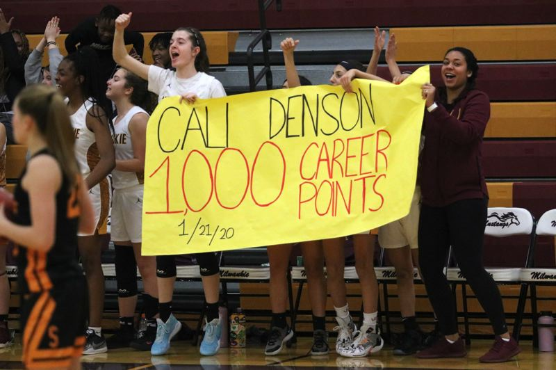 PMG PHOTO: JIM BESEDA - Milwaukie's bench broke into celebration with 1:03 to play in the third quarter after Cali Denson's scored her milestone basket against Scappoose.