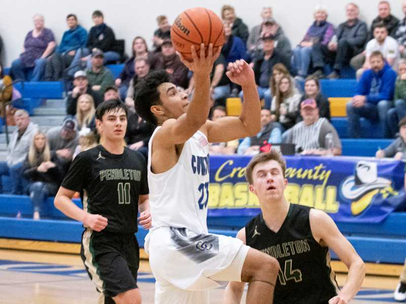 LON AUSTIN/CENTRAL OREGONIAN - Kevin Sanchez drives to the basket for two of his game-high 29 points Friday night against Pendleton.