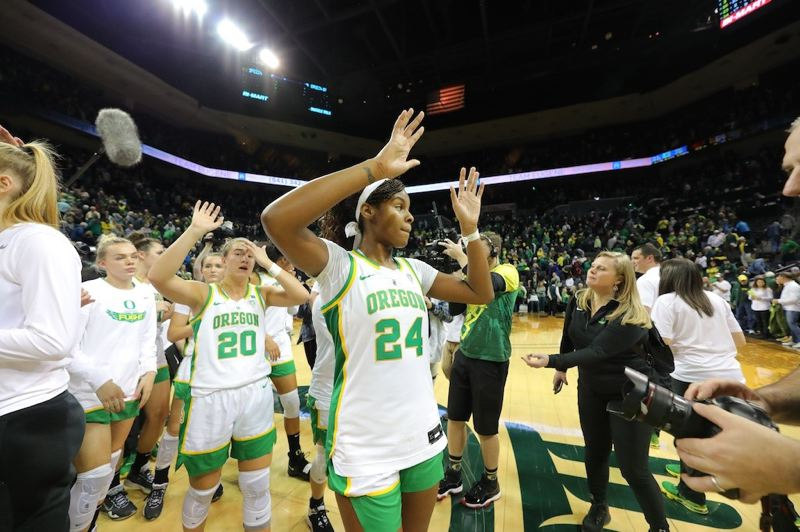 PMG PHOTO: JAIME VALDEZ - Oregon's Ruthy Hebard (24), Sabrina Ionescu (20) and others exit the court at Matthew Knight Arena with a victory over visiting Oregon State on Friday night. The rematch is 1 p.m. Sunday at Corvallis.