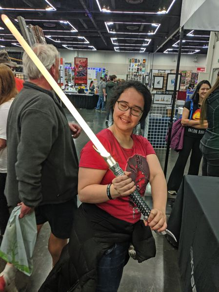 Portland being a dangerous city, one guest wisely brought her own light saber.