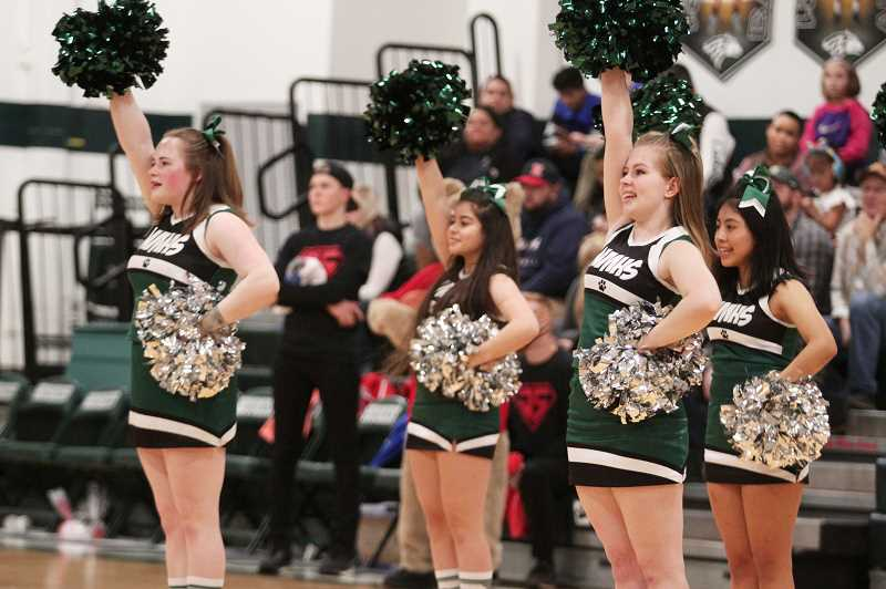 PMG PHOTO: PHIL HAWKINS - The North Marion High Shool cheerleaders performed a joint routine with the junior cheer program at halftime.