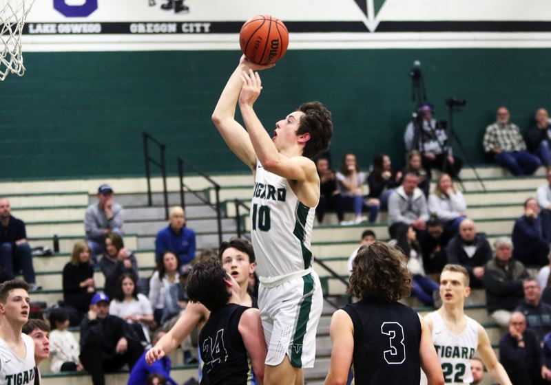 PMG PHOTO: DAN BROOD - Tigard High School junior Jake Wihtol (10) puts up a shot during the Tigers' 72-51 league win over Lakeridge on Friday.