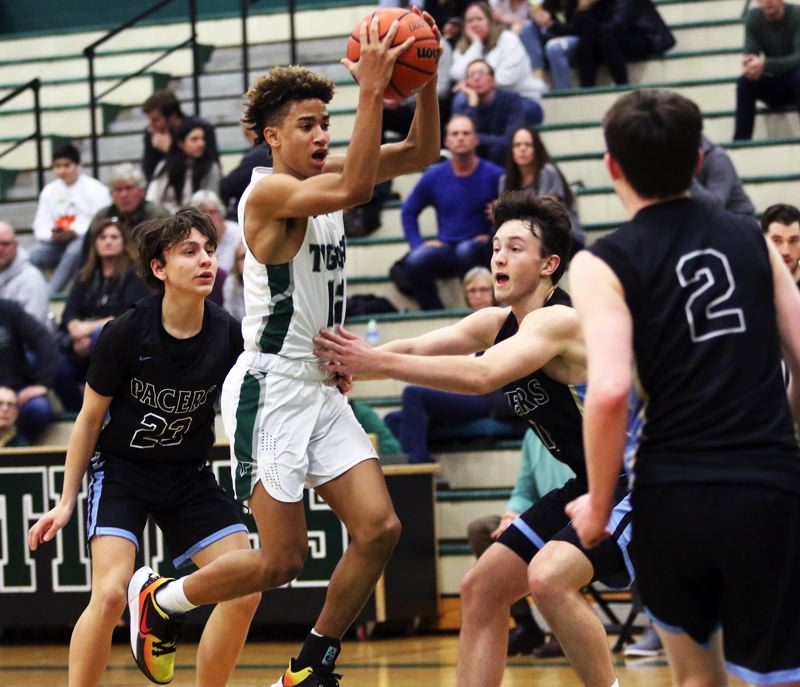PMG PHOTO: DAN BROOD - Tigard High School freshman Malik Brown looks to get to the basket during the Tigers' 72-51 victory over Lakeridge on Friday.