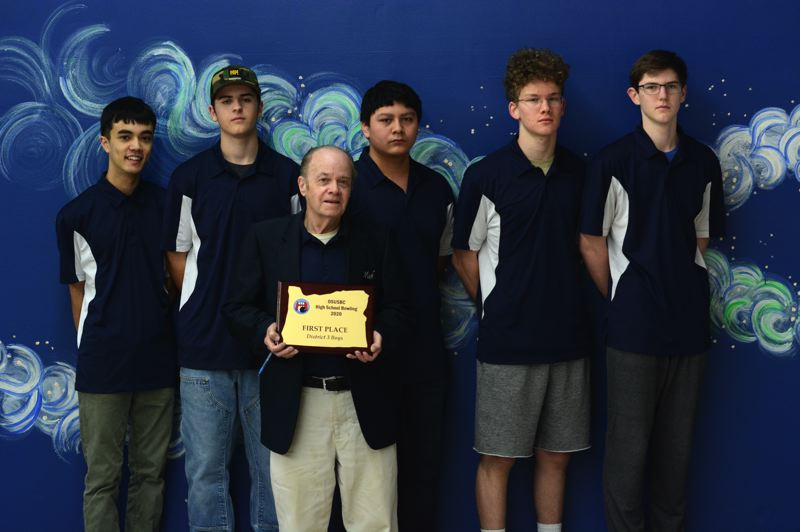 PMG PHOTO: DEREK WILEY - Wilsonville bowlers Lui Blonberg, from left, Trevor Johnson, Gohan Venacia, Spencer Sullivan, Tyler Crawford and Trey Arzie, coached by Mick McMahon, won the District 3 Championship on Sunday, Jan. 19 in Milwaukie.