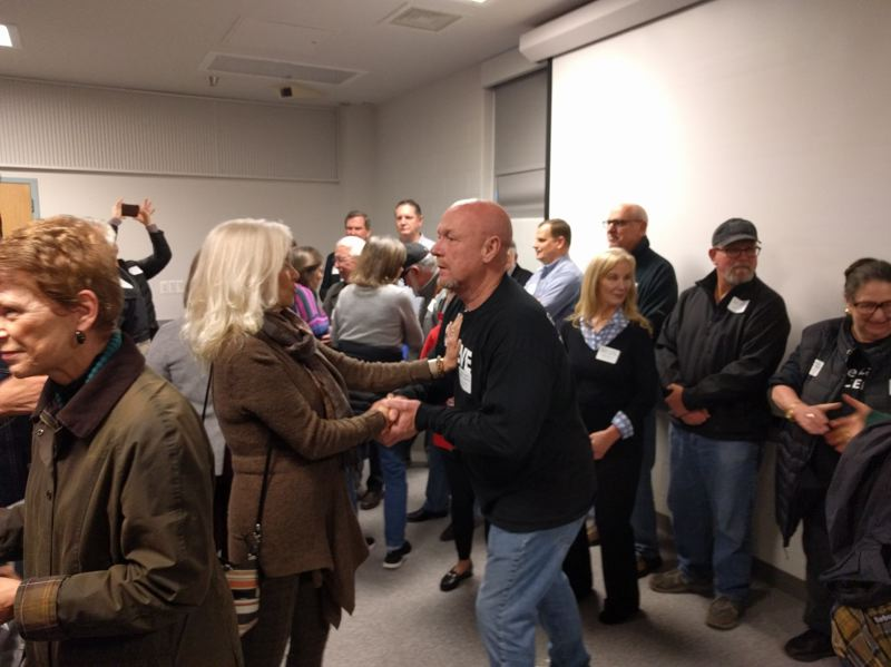 PMG PHOTO: JIM REDDEN - Helping Hands founder Alan Evans talks with a supporter at a crowded open house at the former never-used Wapato Jail