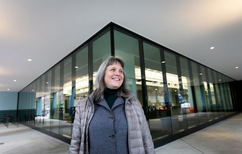 PMG PHOTO: JAIME VALDEZ  - Architect Carla Weinheimer of DLR Group in front of the Portland Buildings revamped loggia, which now has big windows looking in to the new reception, symbolic of open government and ease of access to services.