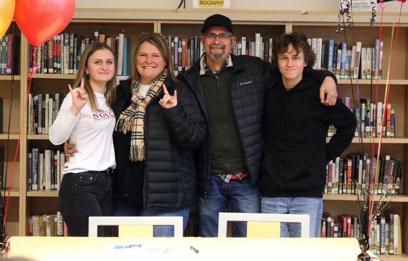 PMG PHOTO: JIM BESEDA - Gladstone's Josie Landrus (left) stands alongside parents Caitlyn and Houston, and brother Owen after signing a letter of intent to play womens soccer at Yakima Valley College in Yakima, Wash.