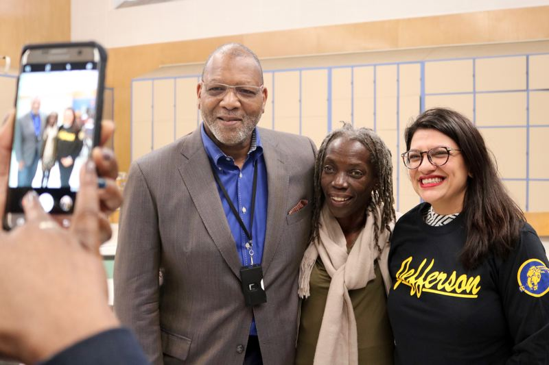 PMG PHOTO: ZANE SPARLING - Rep. Rashida Tlaib was gifted a Jefferson High School t-shirt before posing for photos with Portland Commissioner Jo Ann Hardesty and Kevin Modica.