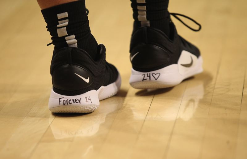 PMG PHOTO: JAIME VALDEZ - Oregon Ducks basketball star Sabrina Ionescu honors the late Kobe Bryant with notations on her shoes for Sunday's game at Oregon State.