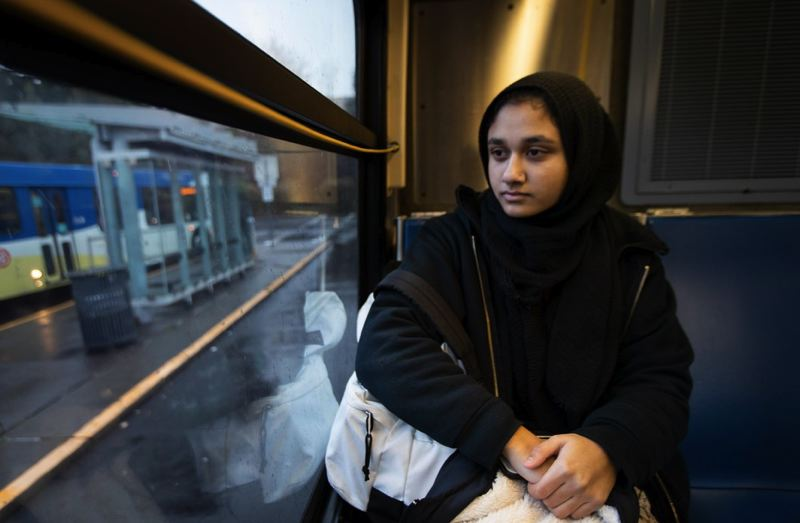 OPB PHOTO - Eqra Raza is a senior at the Muslim Educational Trust in Tigard, Oregon. Raza, 18, rides the TriMet bus everyday for two hours to get to and from school. She says she's always been on guard and has been treated differently for riding public transit while wearing a head scarf.