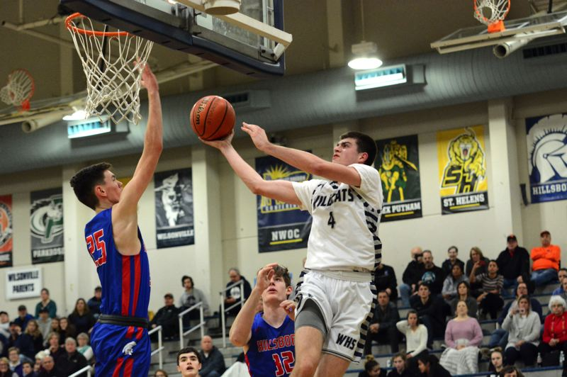 PMG PHOTO: DEREK WILEY - Wilsonville senior Dakota Reber scored 26 points Tuesday at La Salle Prep.