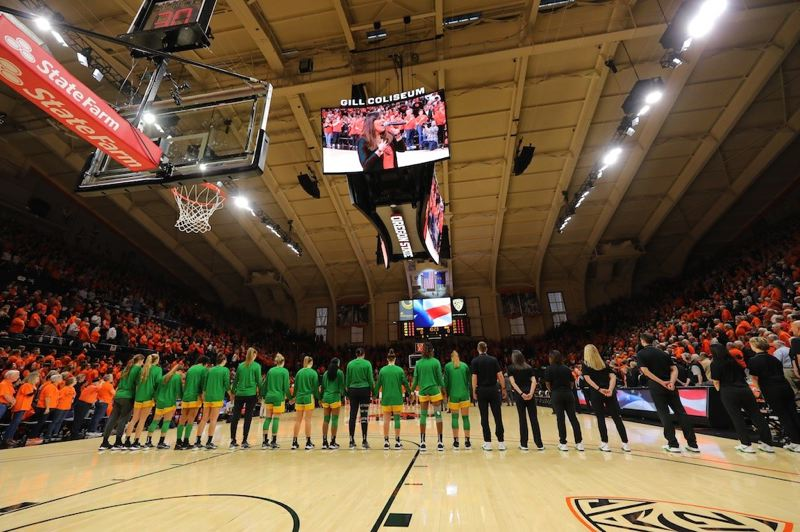 PMG PHOTO: JAIME VALDEZ - Oregon and Oregon State team members line up at Gill Goliseum for a pre-game moment of silence in remembrance of Kobe Bryant, the former Los Angeles Lakers star who was among seven killed in a morning helicopter crash in Southern California.
