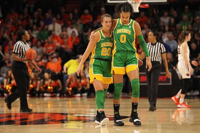 PMG PHOTO: JAIME VALDEZ - Oregon forward Satou Sabally (right) comforts guard Sabrina Ionescu as they head to the bench at Gill Colliseum.