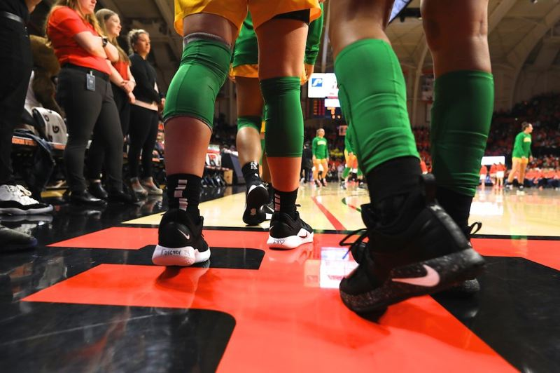 PMG PHOTO: JAIME VALDEZ - Sabrina Ionescu of Oregon heads onto the court at Gill Coliseum in shoes inscribed with a remembrance of Kobe Bryant.