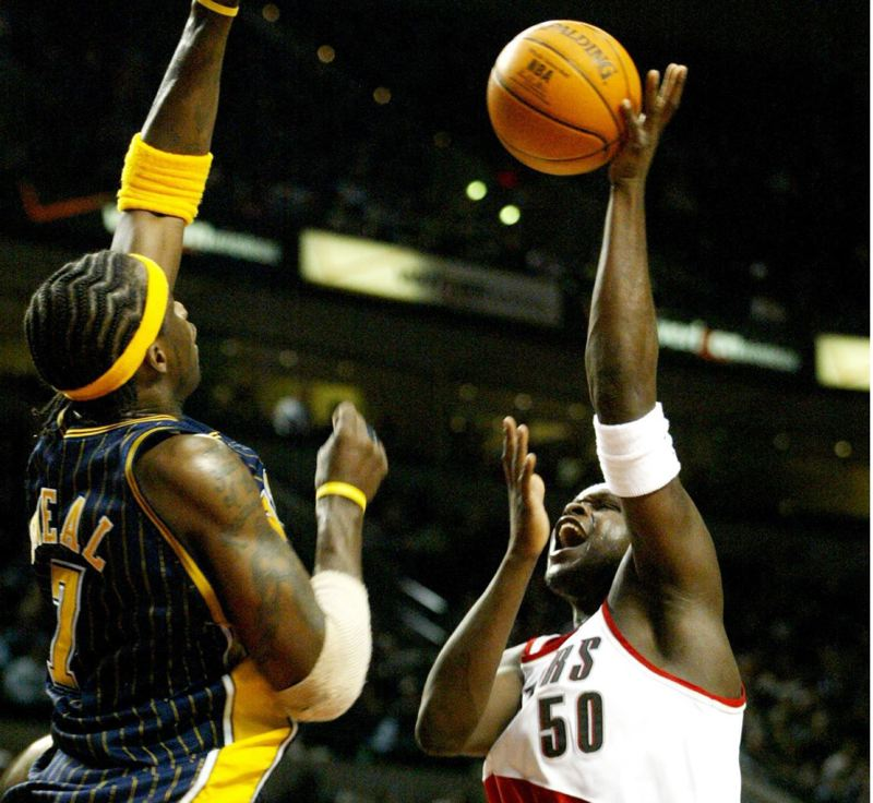 PMG FILE PHOTO: KYLE GREEN - As a member of the Indiana Pacers, Jermaine O'Neal (left) goes up to block a shot by Zach Randolph of the Trail Blazers.
