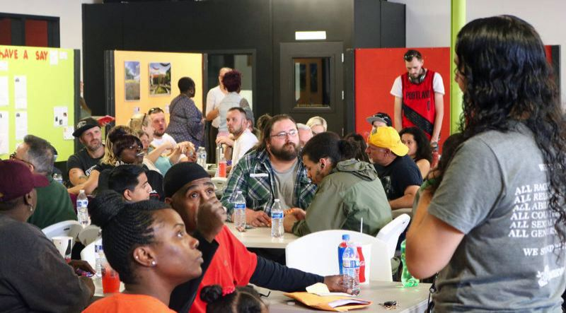 PMG FILE PHOTO: ZANE SPARLING - Local residents gather inside the Rosewood Initiative in June 2018.