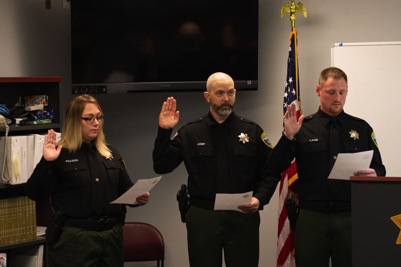 PMG PHOTO: ANNA DEL SAVIO - Three members of the Columbia County Sheriff's Office were promoted to corrections corporal on Wednesday, Jan. 22. Cpl. Sophie Frasier, left, has worked in the Sheriffs Office since 2005. Justen Jump, center, and Boyd Lang, right, were both hired in September 2017.