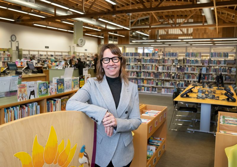 COURTESY PHOTO: MOTOYA NAKAMURA/ MULTNOMAH COUNTY - Vailey Oehlke, director of libraries for Multnomah County, checks things out at the Kenton Library. Shes ready to build a big new flagship library in East Multnomah County.