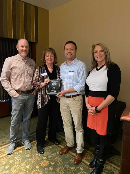 COURTESY PHOTO - From left, Community Association Institute member Kelly Crouch, Charbonneau Country Club Board of Directors member Lindy Anderson, CCC Manager Jim Meierotto, and Community Association Institute member Renee McFarland pose for a photo at the awards presentation luncheon.