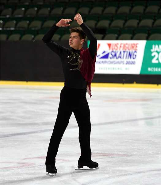 PHOTO COURTESY OF ACTIONPHOTOS BY MARIANNE - Sam Mindra finishes his routine with a spin at the Pacific Coast Sectional Finals in November, where he placed first in the novice division.