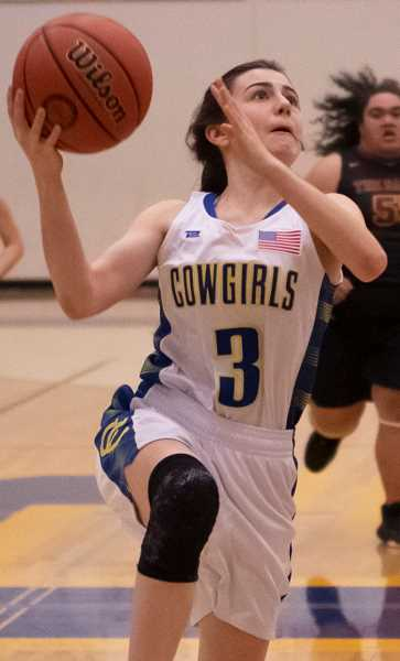LON AUSTIN/CENTRAL OREGONIAN - Taylor Joyce goes to the basket during a home game earlier this year. Joyce, a freshman, is earning more playing time as the season goes on. Joyce scored a point on Friday at Pendleton.