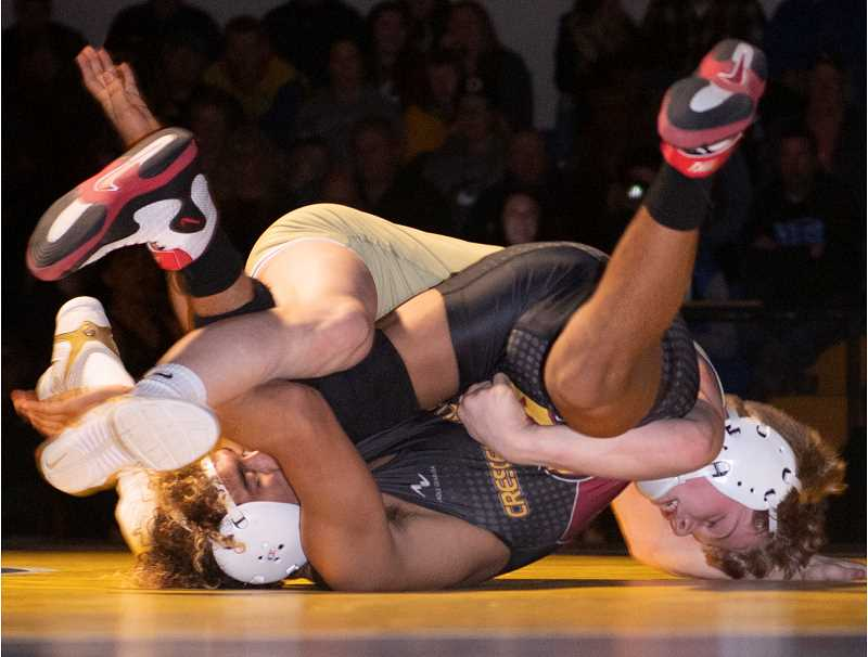 LON AUSTIN/CENTRAL OREGONIAN - Brayden Duke attempts to control Crescent Valley's Basillio Colon during their 145-pound match on Saturday. Duke won the match 5-2, but Crescent Valley won the dual 47-15.