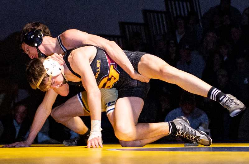 LON AUSTIN/CENTRAL OREGONIAN - Zach Mauras takes down Crescent Valley's Dashle Lamer during their 126-pound match on Saturday. Mauras won the match 7-4, but Crescent Valley easily won the dual meet, winning all but four matches.