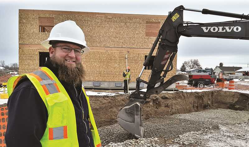 RAMONA MCCALLISTER - Jake Adkins pauses at the construction site near Peters Road and Secure Storage off of McKay Road. Adkins' business, Bartlett Construction, is doing all of the infrastructure and site prep for the 135-unit apartment complex under construction.