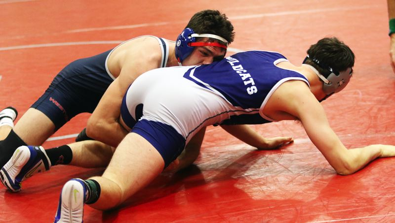 PMG PHOTO: DAN BROOD - Westview High School senior Justus Gabriel (left) battles with Wilsonville's Marshall Rodenbeck in a 152-pound match at Saturday's Winter Warrior Memorial tournament.